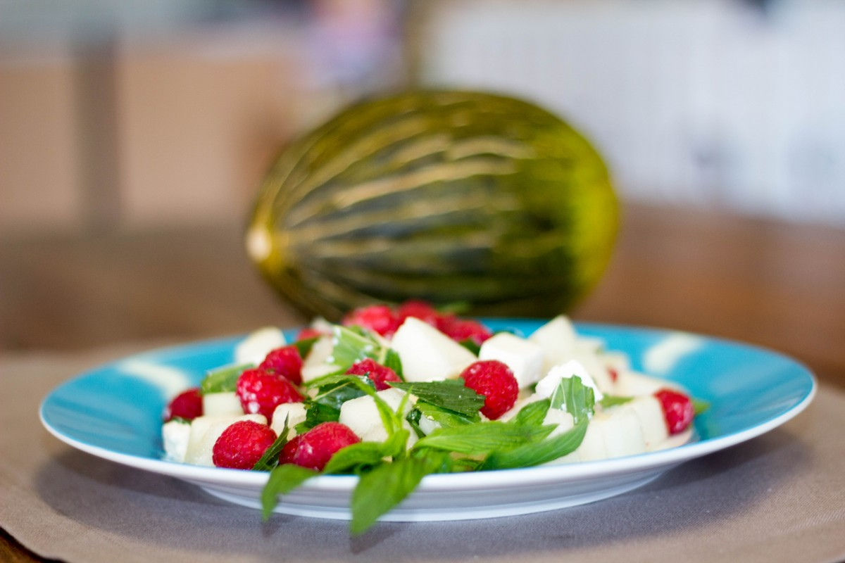 Piel de Sapo Melon salad with feta, mint and raspberries