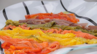 Colourful tapas of roasted peppers and smoked fish
