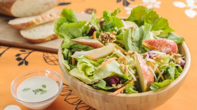 Colorful salad mix with pears, walnuts and Parmesan