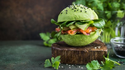 Avocado bun with cucumber ribbons, salmon and spinach