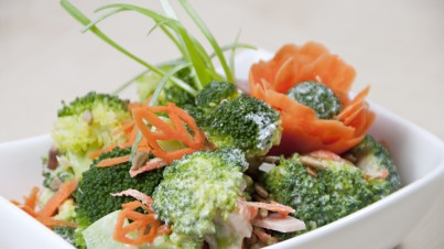 Broccoli salad with carrots, ham and roasted sunflower seeds