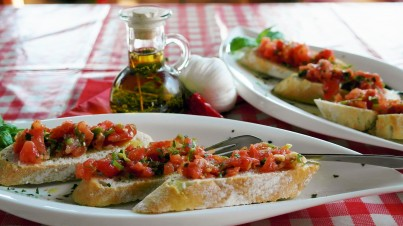 Classic Italian bruschetta with rocket and fresh tomatoes