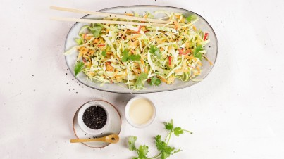 Asian pointed cabbage salad with carrots and chili peppers