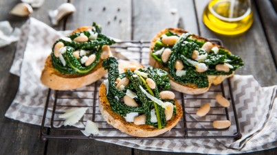Crostini with kale and white beans
