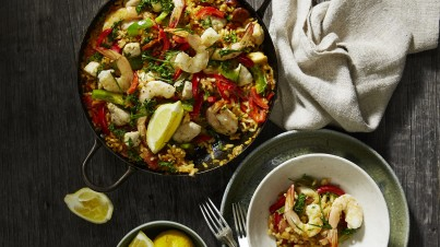 Seafood paella with tomatoes and vegetables