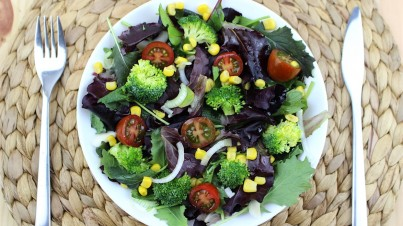 Raw broccoli, corn, and cherry tomato salad