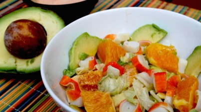 Tropical salad with avocado, orange and cos lettuce