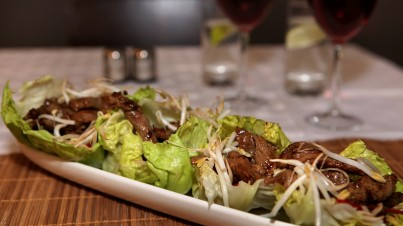 Sizzling steak lettuce cups with soy glaze