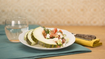 Melon with goat cheese, tomato and cucumber