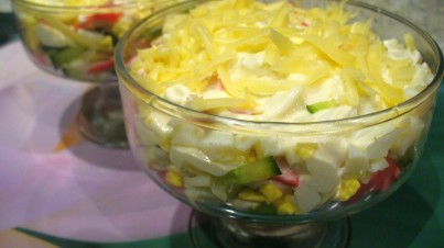 Salad with crab sticks and cucumber
