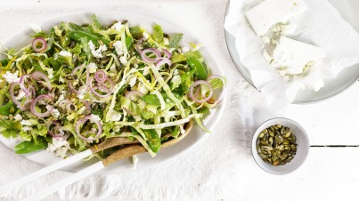 Pointed cabbage salad with onion, snow peas, feta and roasted pumpkin seeds