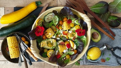 Delicious hearty summer salad with grilled corn and zucchini
