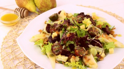 Pear, gouda, and sundried tomato salad with honey mustard vinaigrette