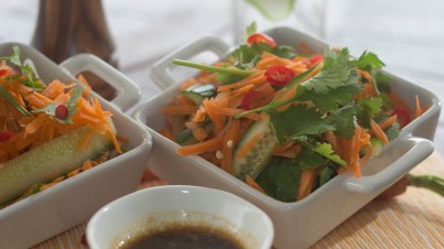 Spicy noodle salad with carrot, cucumber and coriander