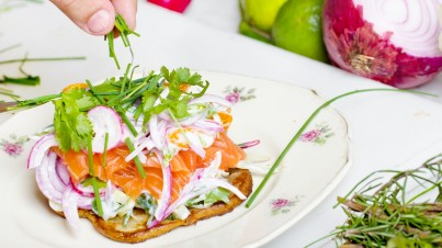 Waffle with salmon avocado and red onion salad