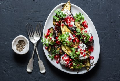 An elegant addition to your Christmas platter: eggplant with pomegranate, mint and a creamy tahini dressing