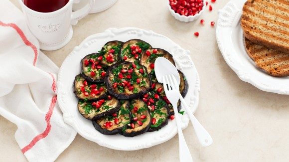 Eggplant salad with saffron yoghurt and pomegranate