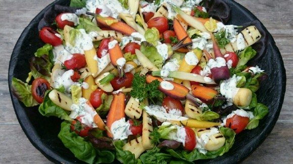 Salad with blistered tomatoes, baby butter leaves, carrot and parsnip