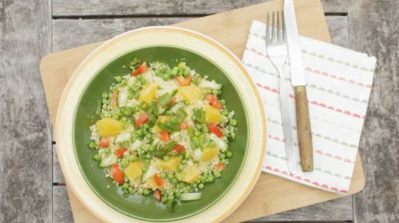 Couscous salad with green peas, capsicum, orange and mint