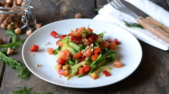 Easy zucchini noodles with capsicum, smoked trout and roasted hazelnuts