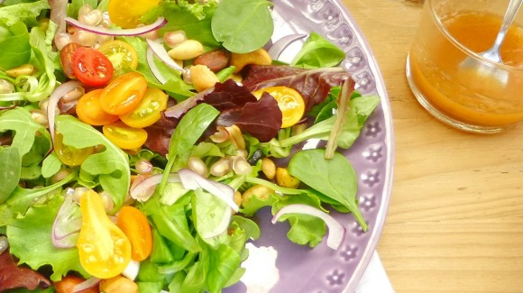 Autumn salad with pomegranate, mixed nuts and quince jelly dressing