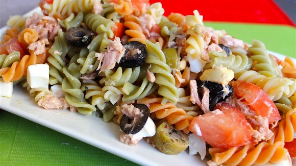 Pasta salad with egg, tuna, tomato and olives