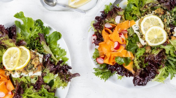 Garlic-crusted fish with salad and a tahini dressing