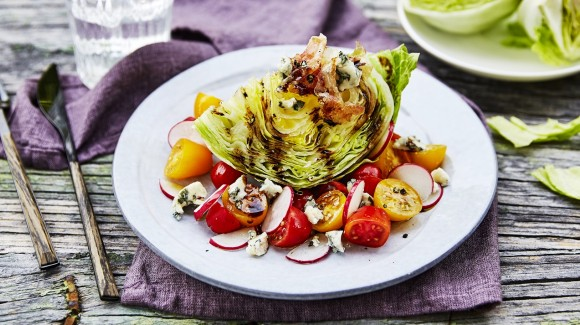 Iceberg wedge salad with tomatoes, radish, blue cheese and pancetta