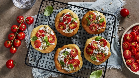 White pizzas with buffalo mozzarella and cherry tomatoes