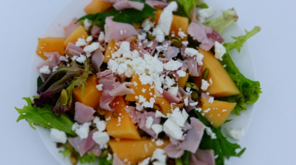 Cantaloupe with parma ham, feta and roasted pumpkin seeds
