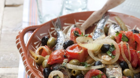 Portuguese oven baked sardine salad with tomato and olives