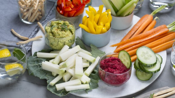 Vegetable snacks with avocado hummus and red beet caviar