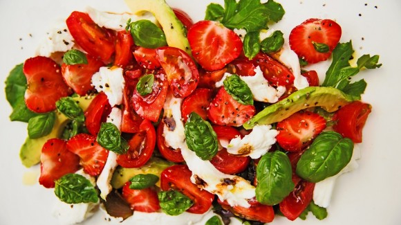 Tomato salad with strawberries, avocado, mozzarella and pomegranate syrup