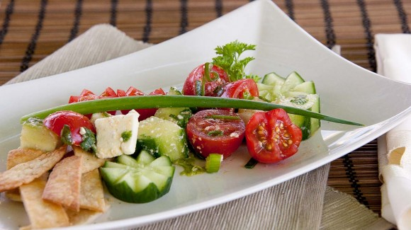 Tomato and goat cheese salad with crisp tortillas